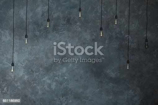 Light bulbs lamps on gray wall of plaster background loft horizontal light bulbs lamps on gray wall of plaster background loft horizontal texture vintage wall in the room interior made of the old wall grungy wide copy space aloadofball Gallery