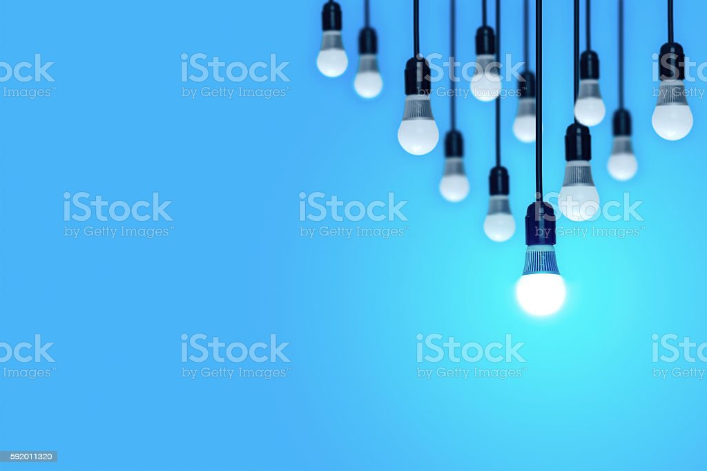 Light bulbs on a blue background. стоковое фото