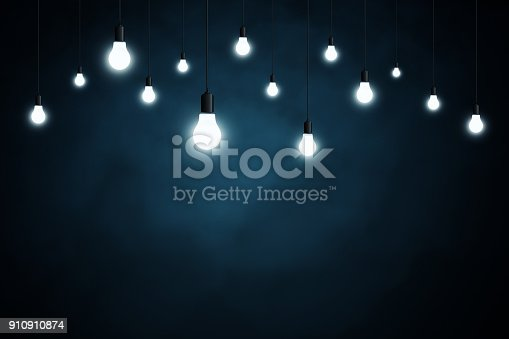 istock Light bulbs on dark blue background 910910874