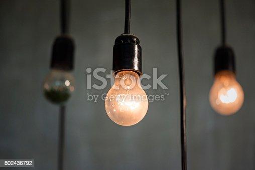 940992564 istock photo Light bulbs on gray background 802436792