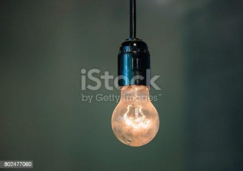 940992564 istock photo Light bulbs on gray background 802477060