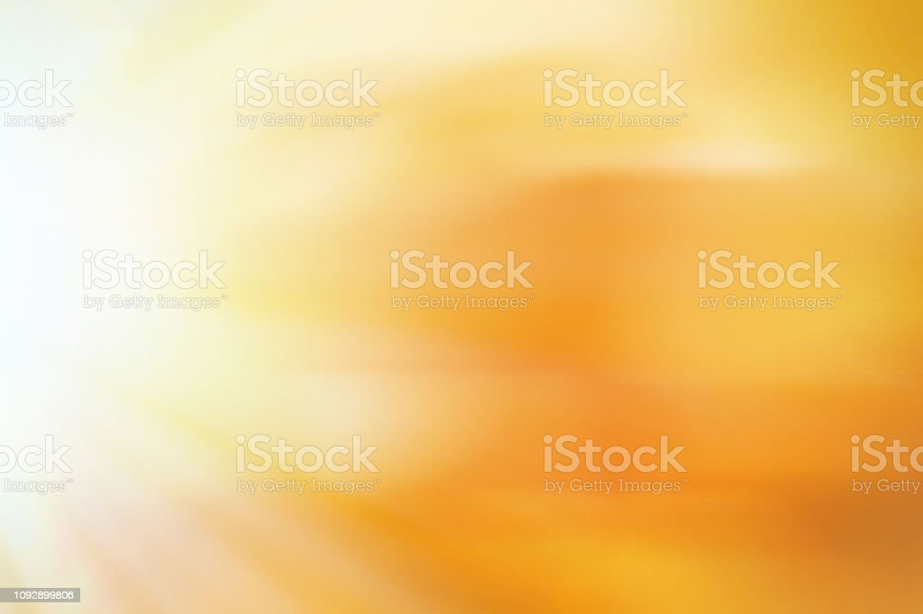 Light burst orange abstract elegant background stock photo