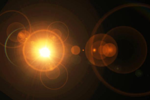 éclats de lumière - cercle concentrique photos et images de collection