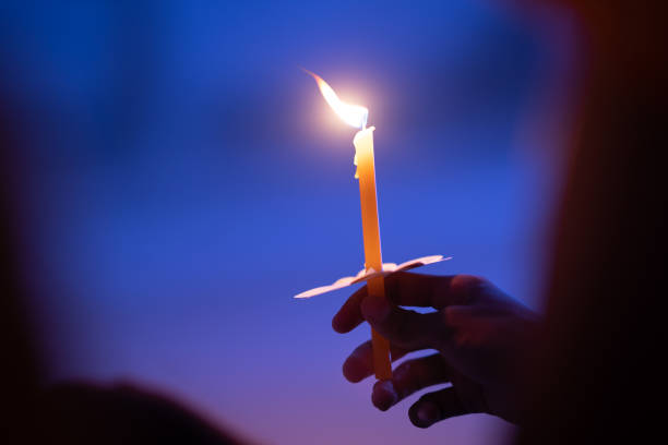 Light candle buring in celebration and spirit meditation Light candle buring in celebration and spirit meditation place of worship stock pictures, royalty-free photos & images