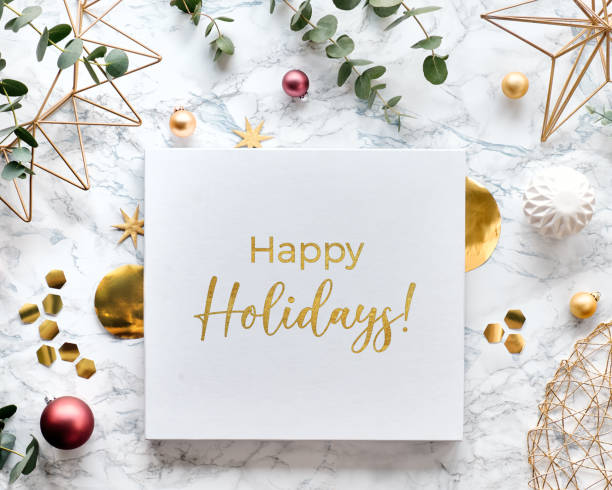 light christmas frame with fresh eucalyptus twigs and golden geometric decorations - hexagons, trinkets and wire shapes. flat lay on white marble background with text happy holidays in golden text. - happy holidays stock pictures, royalty-free photos & images