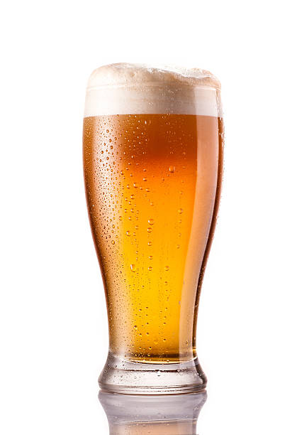 light cold beer in frosty glass isolated on white light cold beer in frosty glass isolated on a white background beer glass stock pictures, royalty-free photos & images