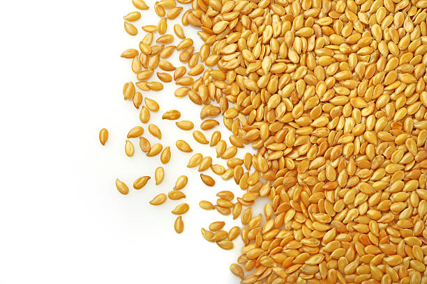 Light colored seeds spilled on white background stock photo