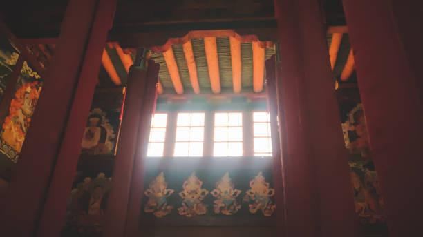 Light coming through windows inside Hemis Monastery, Ladakh. Light coming through windows inside Hemis Monastery, Ladakh. place of worship stock pictures, royalty-free photos & images