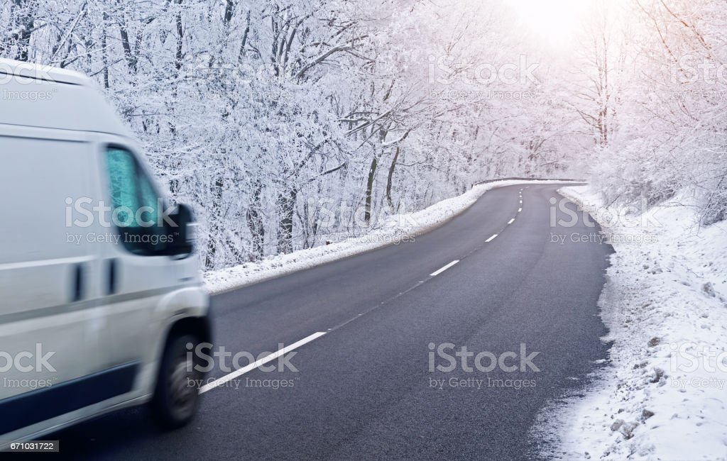 Light commercial vehicle on road in winter stock photo