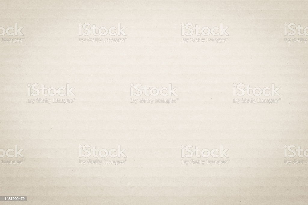 Light cream beige brown color corrugated cardboard paper texture...