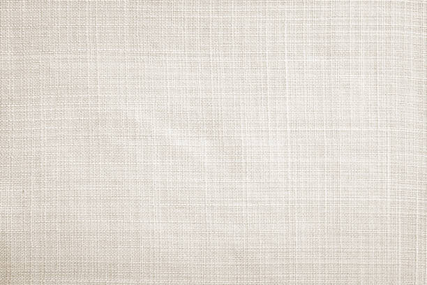 light cream fabric texture background - textile stock photos and pictures