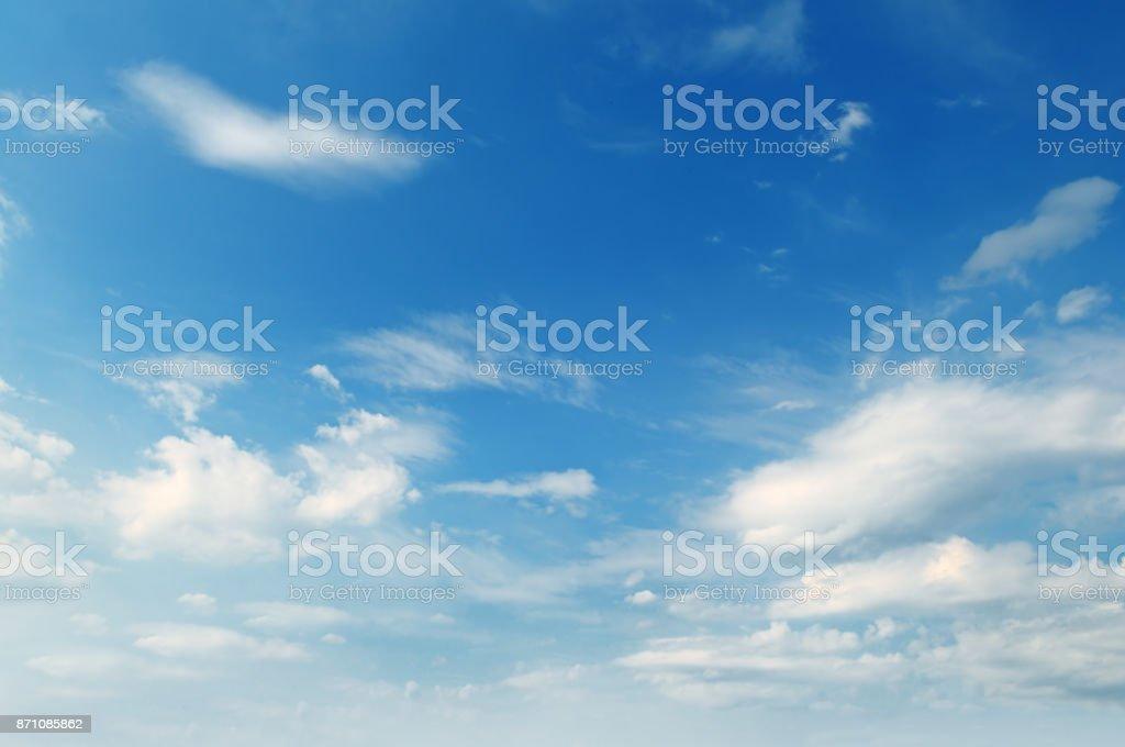 light cumulus clouds in the blue sky stock photo