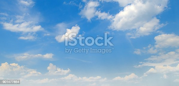 istock Light cumulus clouds in the blue sky. Wide photo. 901477854