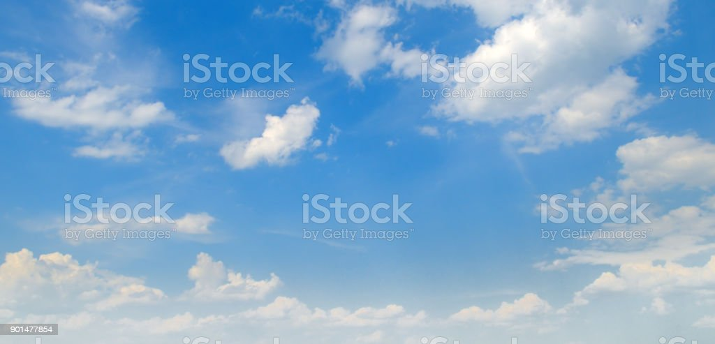 Light cumulus clouds in the blue sky. Wide photo. stock photo