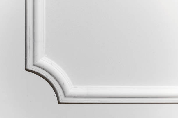 Light decorative item made of white plaster on ceiling close-up Light decorative item made of white plaster on ceiling close-up plaster ceiling design stock pictures, royalty-free photos & images