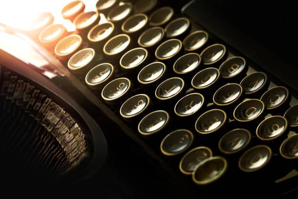 Light effect on typewriter keyboard stock photo