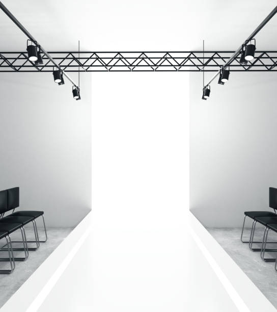 Light empty fashion runway Light empty fashion runway podium stage interior with seats, lights and copyspace. 3D Rendering ramp stock pictures, royalty-free photos & images