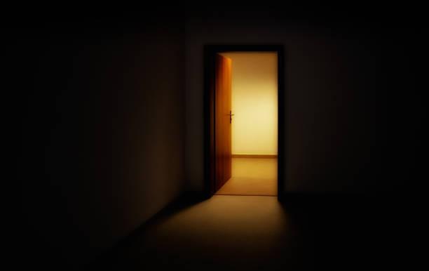 Light entering through open doors in room stock photo