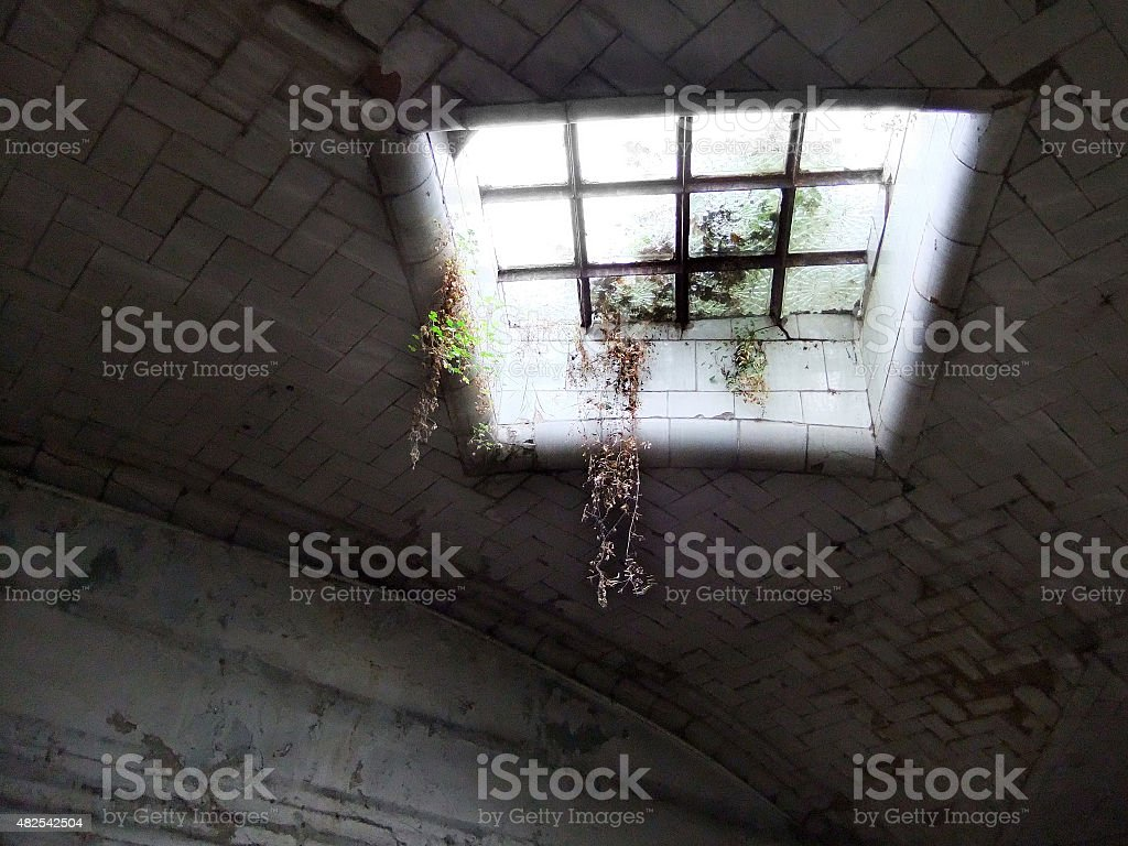 Light enters through a window from above stock photo