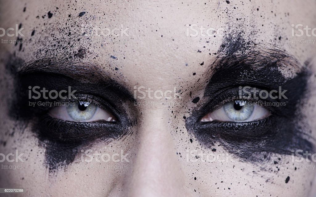 Light eyes in a world surrounded by darkness stock photo