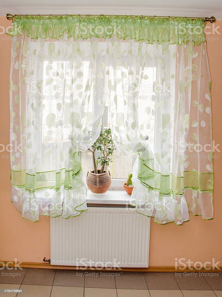 Light Fabric Curtains In Sunshine Day Draperies On Windows Stock