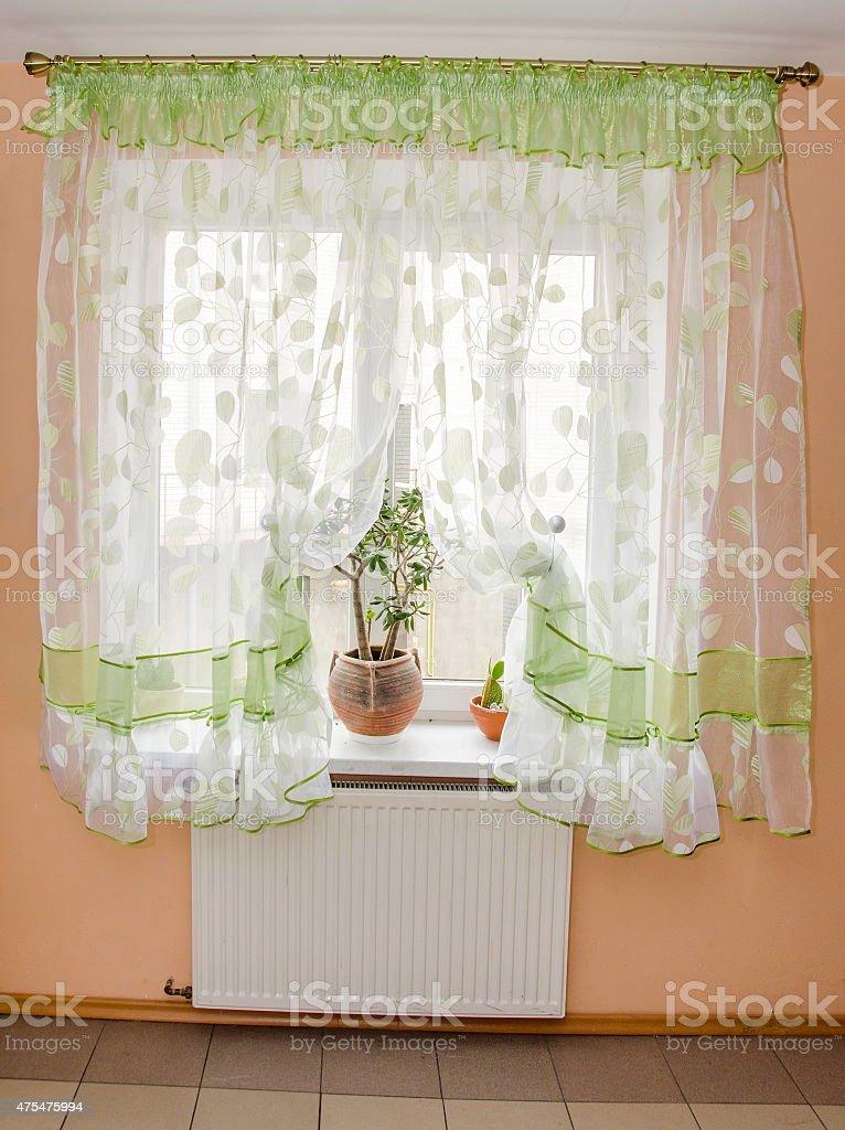 Light Fabric Curtains In Sunshine Day Draperies On Windows Stock