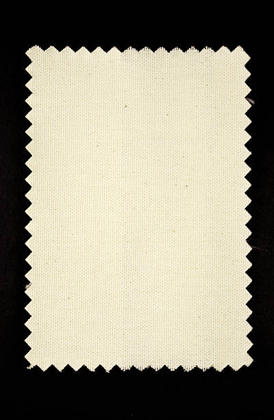 light fabric swatch on black background stock photo