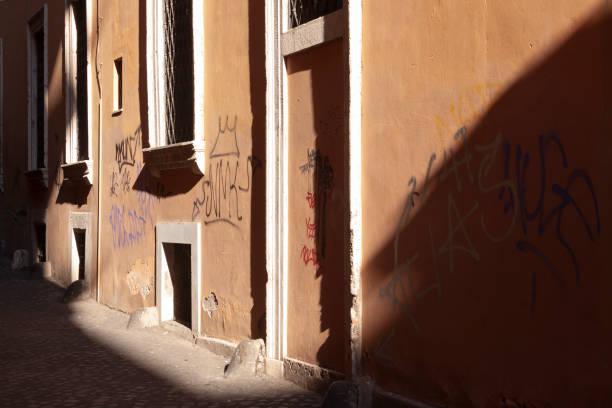 light falls in rome - rome road central view foto e immagini stock