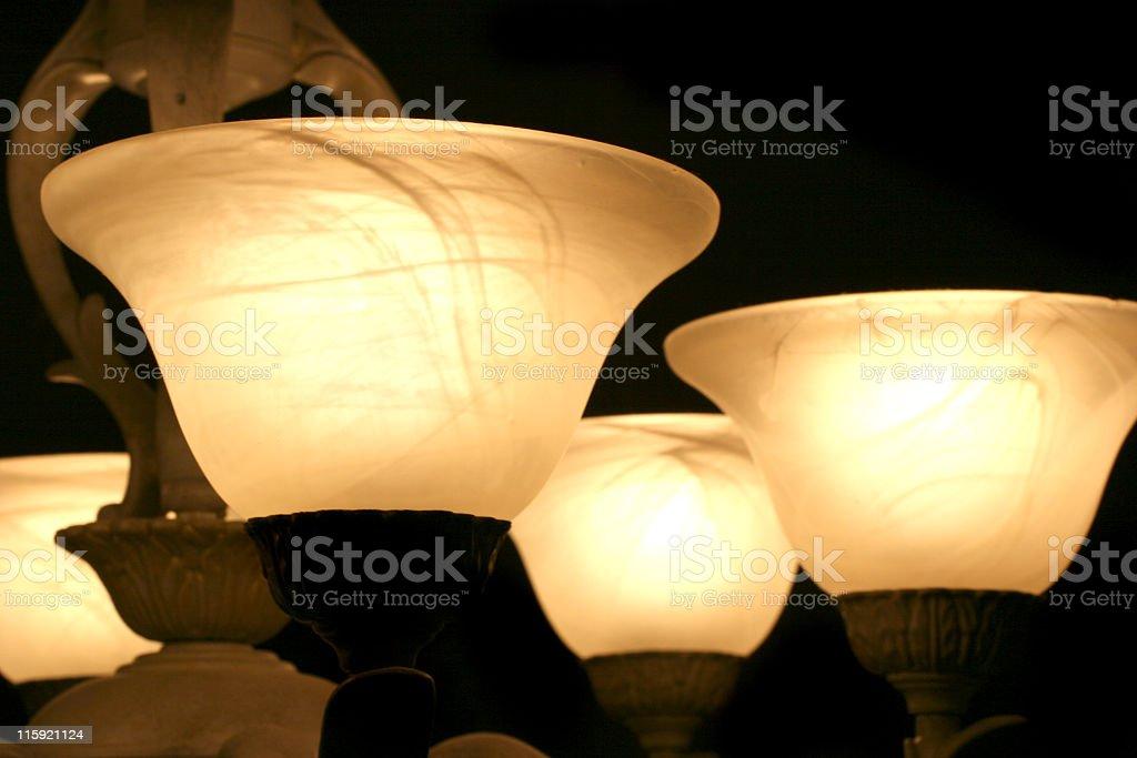 Light Fixture close up. Globes. Lit. Dining room. stock photo