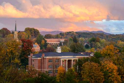 Milligan College, TN, USA - October 18, 2012: Light from a setting sun reflects off clouds over the autumn landscape around the campus of Milligan College, a Christian liberal arts college founded in 1866.