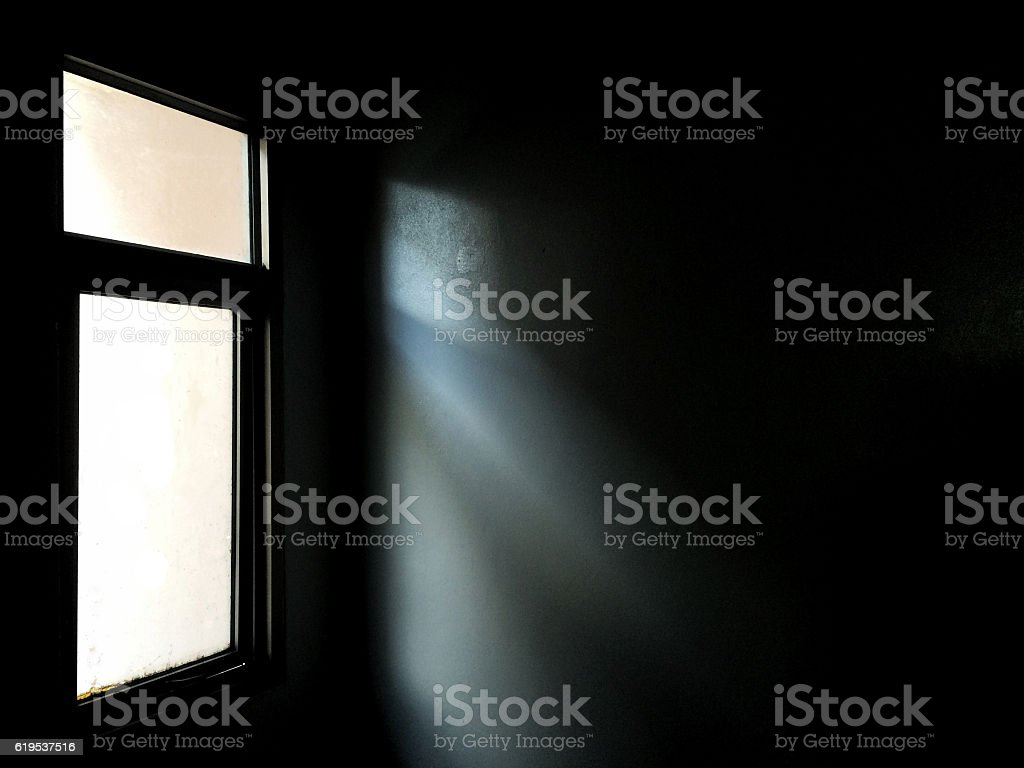 Light from a window in the dark room stock photo