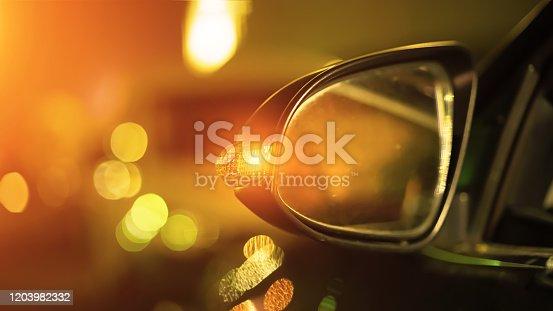 istock light from headlamps car at night street 1203982332