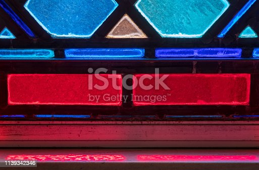 691464522 istock photo Light from stained glass window in american catholic church 1139342346