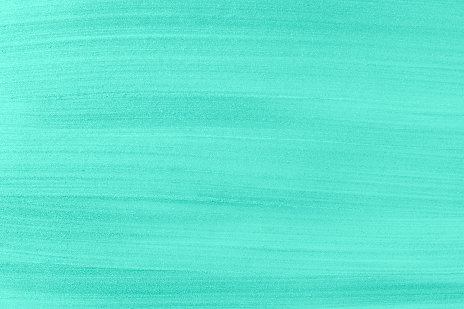 1202746861 istock photo Light glossy turquoise acrylic paint textured background close up. 1216815919