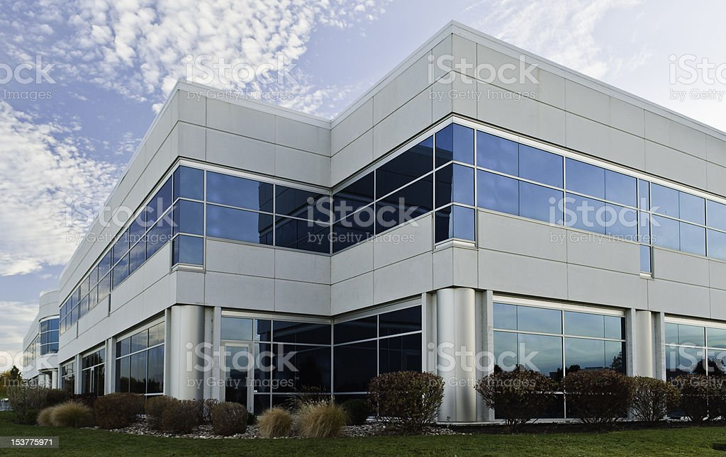 Light Gray Office Building on a Blue Sky stock photo