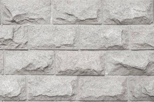 licht grijze ruwe marmeren steen textuur - versterkte muur stockfoto's en -beelden