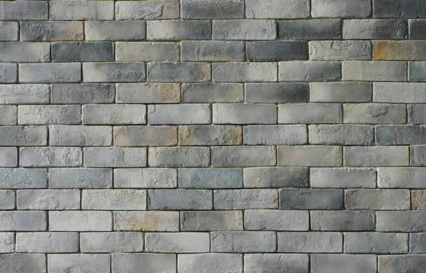licht grijze ruwe marmeren stenen textuur - versterkte muur stockfoto's en -beelden