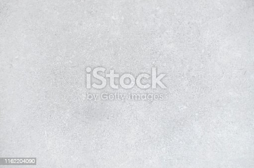 istock Light gray textured concrete background. 1162204090