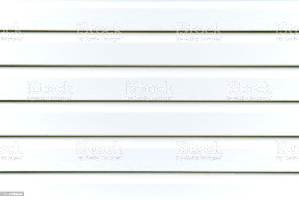 Light gray vinyl siding background. stock photo