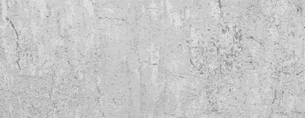 Hellgrau verwitterte Steinmauer mit Rissen. Beton Wand Hintergrund Textur. – Foto