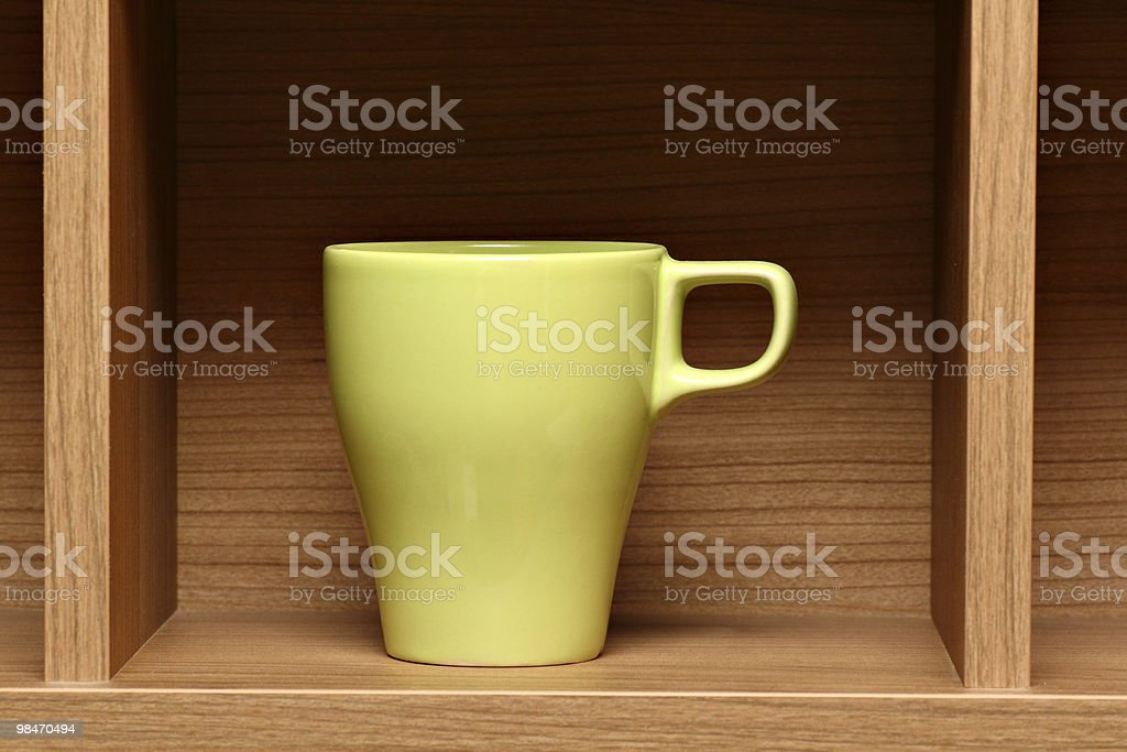 Light green coffee cup on wooden shelf royalty-free stock photo