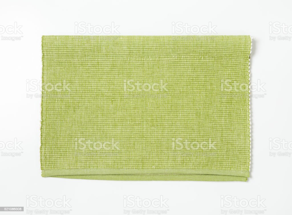 Light green cotton placemat stock photo