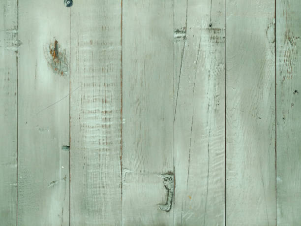 light green stained wood panel wall fence background stock photo