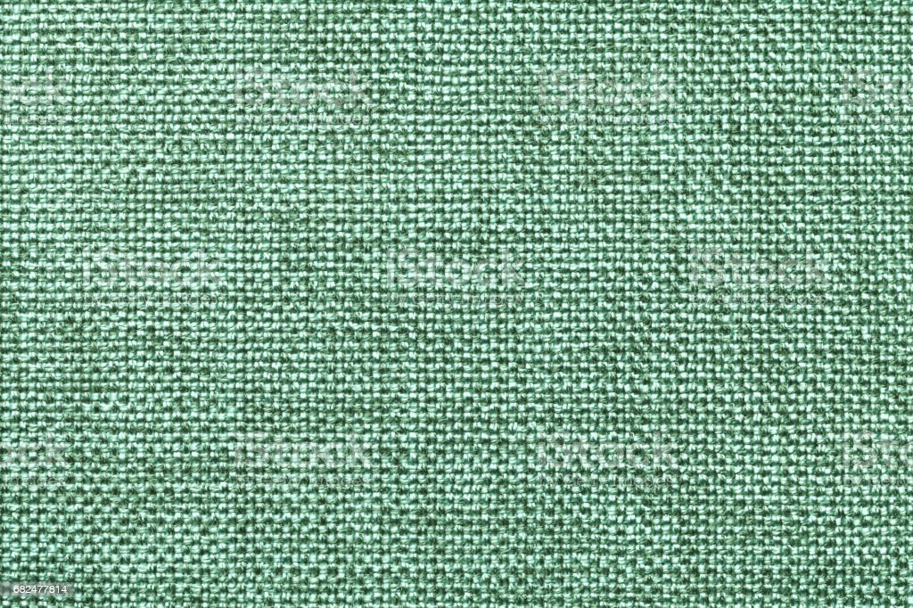 Light green textile background closeup. Structure of the fabric macro royalty-free stock photo