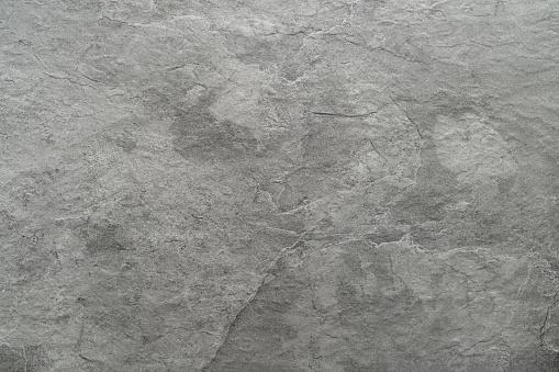 Light grey black slate stone background or texture