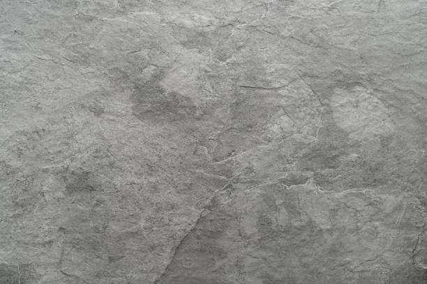 Light grey black slate stone background or texture Light grey black slate stone background or texture granite rock stock pictures, royalty-free photos & images