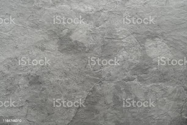 Photo of Light grey black slate stone background or texture