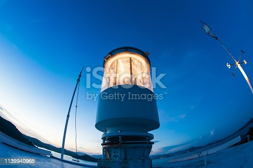 615497916 istock photo Light house at twilight photographed with a fisheye lens. 1139940965