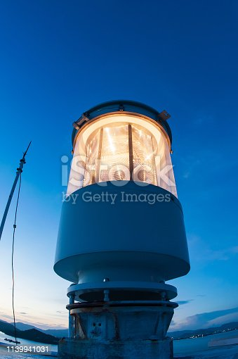615497916 istock photo Light house at twilight photographed with a fisheye lens. 1139941031