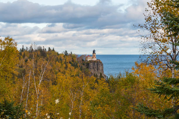 Light house in Northern Minnesota surrounded by autumn foliage stock photo